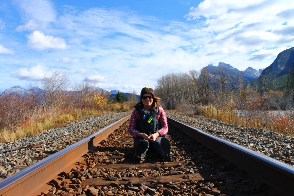 Sam sitting on the railway tracks.